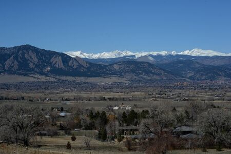 Boulder nestled beside the Rockies photo
