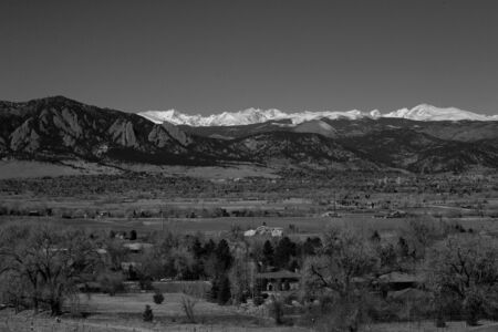 Black and White Boulder nestled beside the Rockies photo
