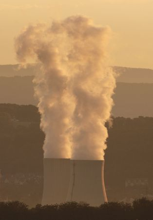 powerplants: Smokes of electric  coal power plant at Sunset in Germany - Volklingen - Saarland Stock Photo