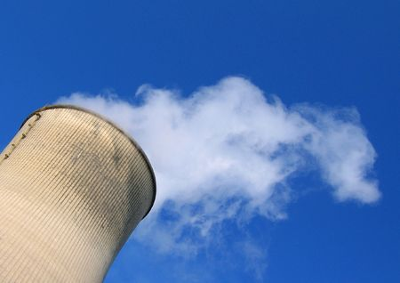 close up chimney: Steam going out of a cooling tower of a coal power plant into blue sky