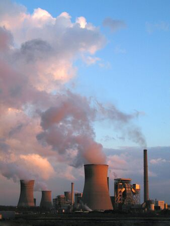 nuclear energy: Coal fired power plants generanting smokes at the sunset