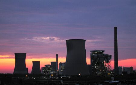 fired: silhouette of Coal fired power plants at the sunrise