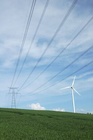 a windturbine close to a electric pylon in France Stock Photo - 3437933