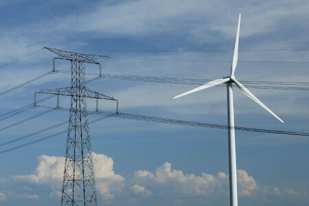 generating station: a windturbine close to a electric pylon in France