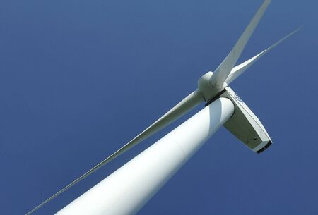 close up of pylons windturbine on blue sky in France Stock Photo