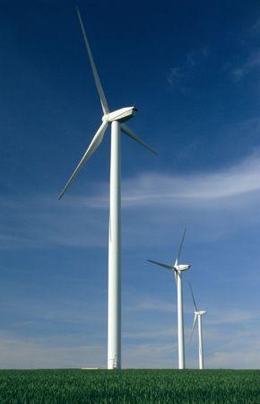 Three windturbines on blue sky France Stock Photo