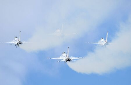 vapour: White smokes of F-16 jet fighters - the aerobatic team Thunderbirds - Arctic Thunder airshow 2008 - Anchorage - Alaska - USA