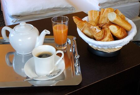 a french breakfast served into a hotel bedroom at Paris photo