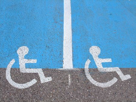 Lines and symbols   for disabled persons  on parking supermarket Stock Photo