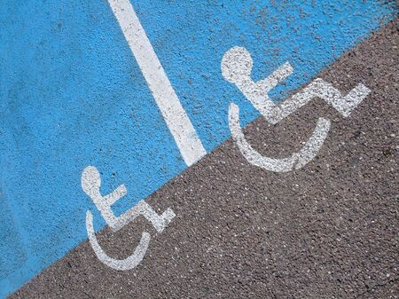 Lines and symbols  for disabled persons  on a parking supermarket photo