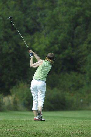 Woman golfer doing a swing