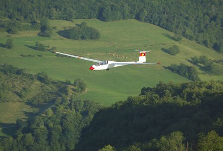 A glider Janus A flying over Alps Mountains at Challes les eaux France