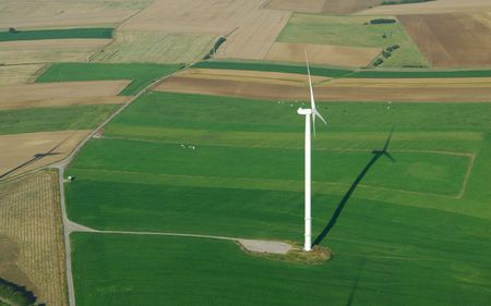 windturbines: Aerial view of a lonely  windturbine in green meadow France Europe