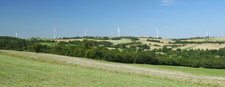 regenerative: Panorama of windfarm over a hill in France Stock Photo
