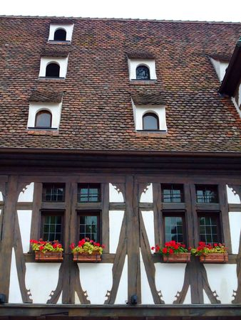 half  timbered: Half timbered wall and roof in Alsace region - Obernai France Stock Photo