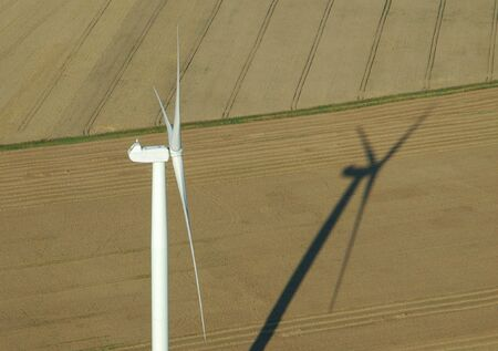 windturbines: aerial view of wind turbine and shadow France Europe Stock Photo