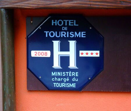 Official classification of french hotels, here a four stars board sign at Paris City France