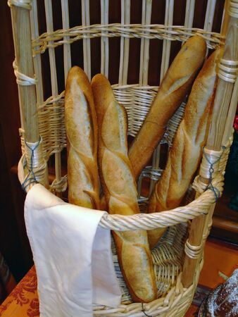 Basket of french bread sticks baguette photo