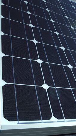 Electric photovoltaic solar panels cells on a home roof photo