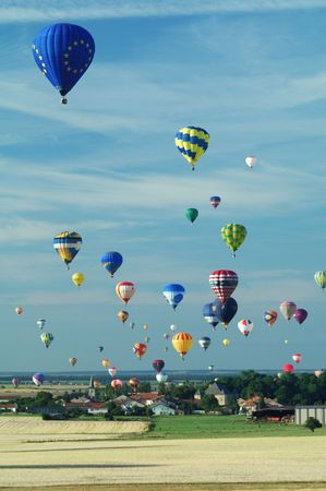 hot air ballloons flying over french village - Europe