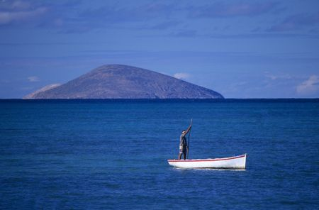 Local boat with fisherman at Cape Malheureux, Mauritius Island, Indian Ocean Stock Photo - 7605662