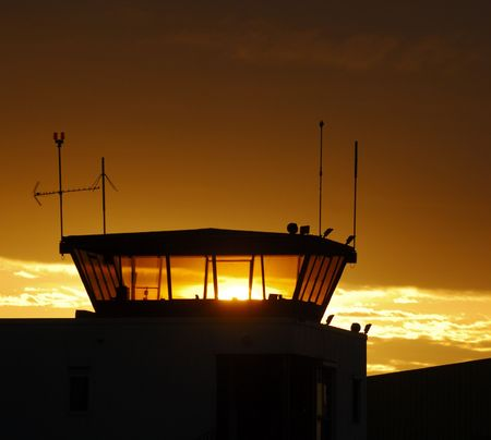 Air traffic control tower on sunset sky, France photo