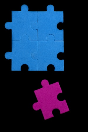 Textured puzzle pieces that show being different, original, special... over black background Stock Photo - 18780703