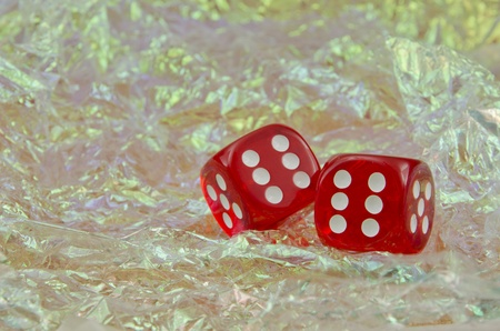 6 12: Pair of red dice over blue background showing a roll of twelve Stock Photo