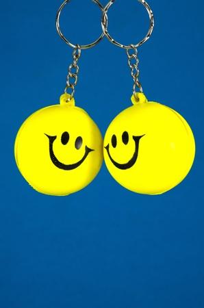 fullness: Yellow smiley couple on blue background