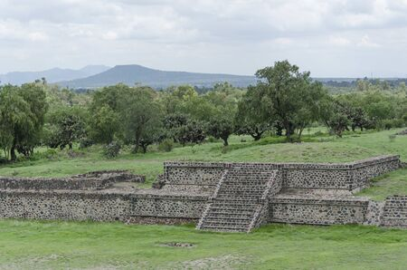 Grass-covered Pre-Hispanic Mesoamerican platforms showing the talud-tablero architectural style, in Teotihuacan, Mexico 写真素材