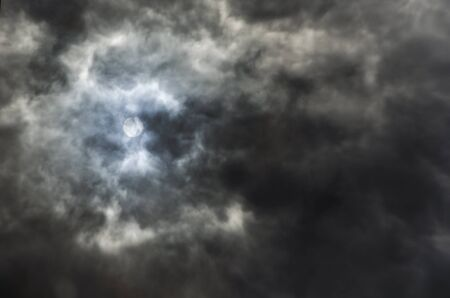 Strange reflection of a stormy sky, dark clouds filling the frame