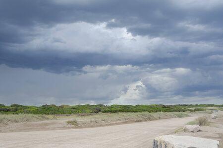 Landscape: summer storm sky and dirt road