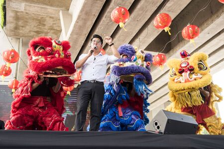 Capital Federal, Buenos Aires / Argentina; Jan 25, 2020: Carlitos Lin surrounded by Chinese lions at the opening of the celebrations for the Chinese New Year
