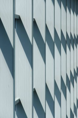 Modern architecture, parallel vertical lines, and diagonals; light and shadow areas, color