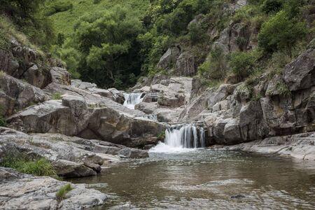 Beautiful river landscape, small waterfall in Cordoba, Argentina