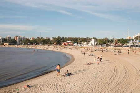 Montevideo / Uruguay, Dec 28, 2018: sandy beach along the bank of the Rio de la Plata, a summer evening