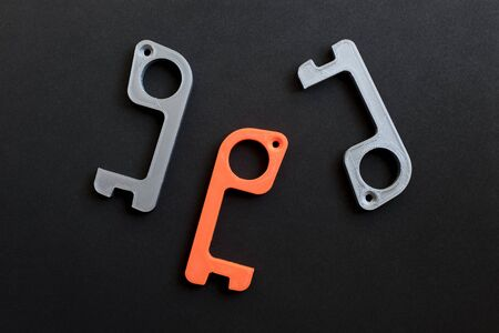 Plastic tools made in 3d printer to open doors and press buttons without touching them, to avoid the spread of the coronavirus disease, Covid-19. New normal.
