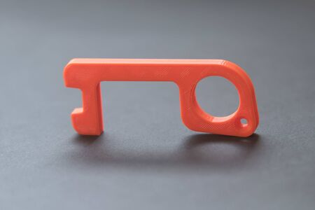 Plastic tool made in 3d printer to open doors and press buttons without touching them, to avoid the spread of the coronavirus disease, Covid-19. New normal. Stok Fotoğraf