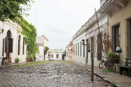 Colonia del Sacramento / Uruguay; Jan 2, 2019: beautiful cobbled street in the historical center of the city, on a cloudy summer morning