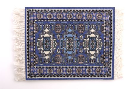 A miniature Persian rug. (isolated, 12 MP camera) Фото со стока