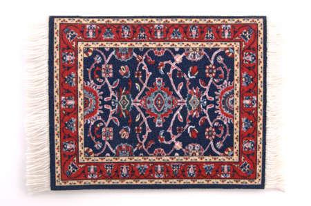 A miniature Persian rug. (isolated, 12MP camera)