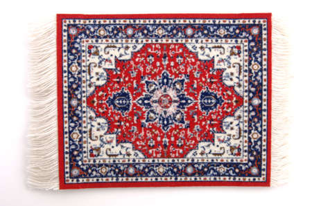 A miniature Persian rug. (isolated, 12MP camera)