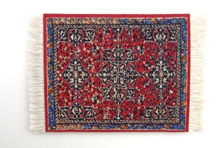 A miniature Persian Rug. (isolated, 12 MP camera)