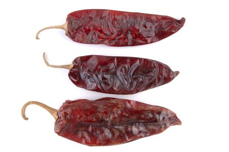 A trio of dried chile (chili) peppers. (Isolated, macro, 12MP camera)