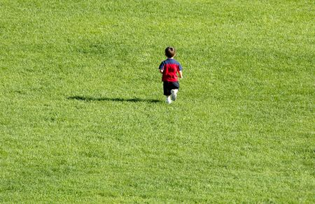 Boy running on grass. 12MP camera.