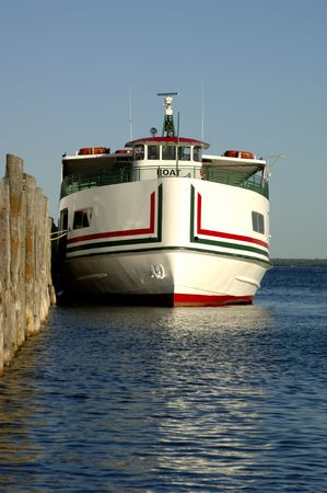 A ferry boat docked at Mackinac Island, Michigan. Focus = the ferry. 12MP camera.