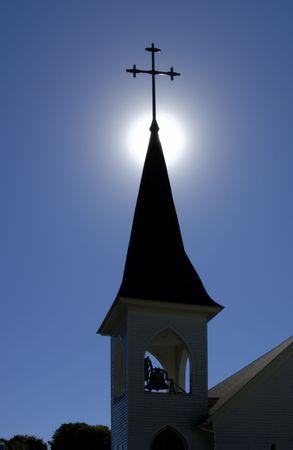 A backlit church spire with belfry. (12MP camera) Фото со стока