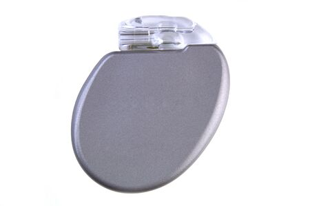 An ICD (Implantable Cardioverter Defibrillator) with pacemaker, 11mm thin, 30cc volume, 2.9 ounces, will be surgically placed in the chest wall.(12MP camera, isolated, macro)