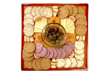 Snacks on a handmade platter that has curved edges. Focus = the olive group. 12MP camera.