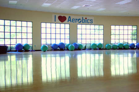 A row of gym balls in a gymnasium used for aerobics awaits the next session. 12MP camera. Фото со стока